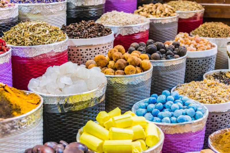 Spices and herbs on the arab street market stall. Variety of spices and herbs on the arab street market stall. Dubai Spice Souk, United Arab Emirates stock photo
