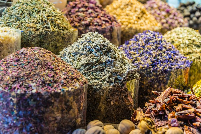 Spices and herbs on the arab street market stall. Variety of spices and herbs on the arab street market stall. Dubai Spice Souk, United Arab Emirates royalty free stock photography