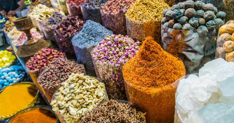 Spices and herbs on the arab street market stall. Variety of spices and herbs on the arab street market stall. Dubai Spice Souk, United Arab Emirates royalty free stock photos