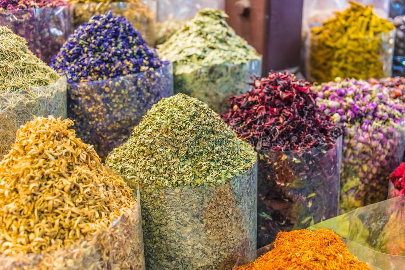 Spices and herbs on the arab street market stall. Variety of spices and herbs on the arab street market stall. Dubai Spice Souk, United Arab Emirates stock photos