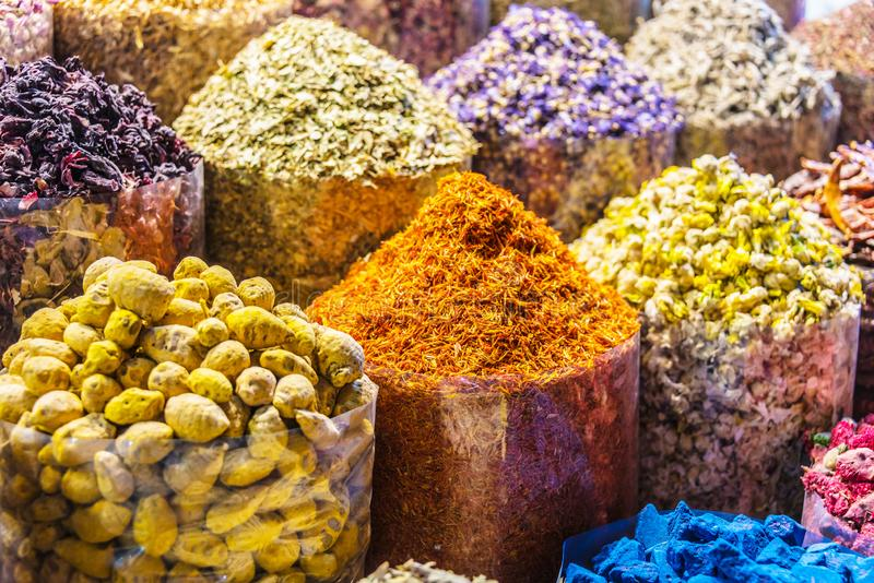 Spices and herbs on the arab street market stall. Variety of spices and herbs on the arab street market stall. Dubai Spice Souk, United Arab Emirates stock photography
