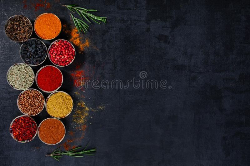 Spices and herbs on a black background royalty free stock images