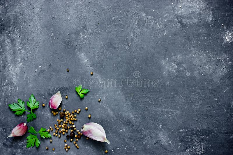 Spices, herbs and greens ingredients for cooking food background stock images