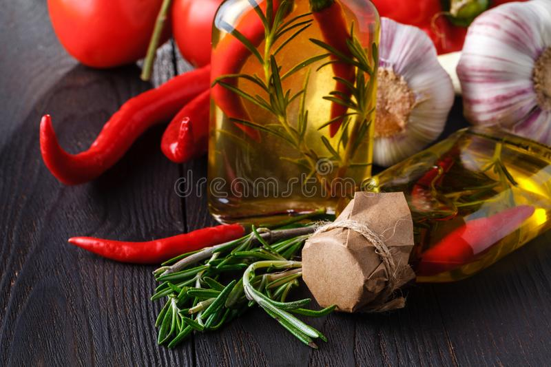 Spices and herbs ingredients in decorative glass bottles,kitchen decoration stock photography