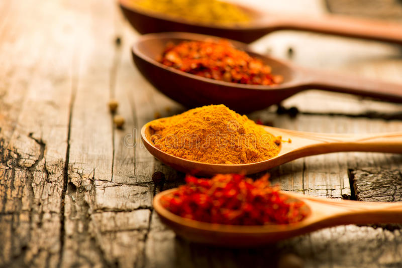 Spices and herbs over wooden background royalty free stock image