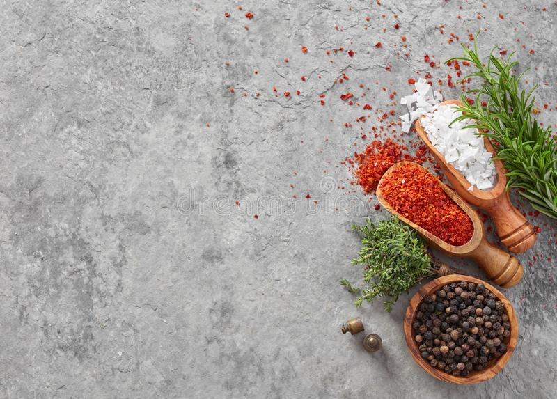 Salt, pepper, paprika and herbs royalty free stock images