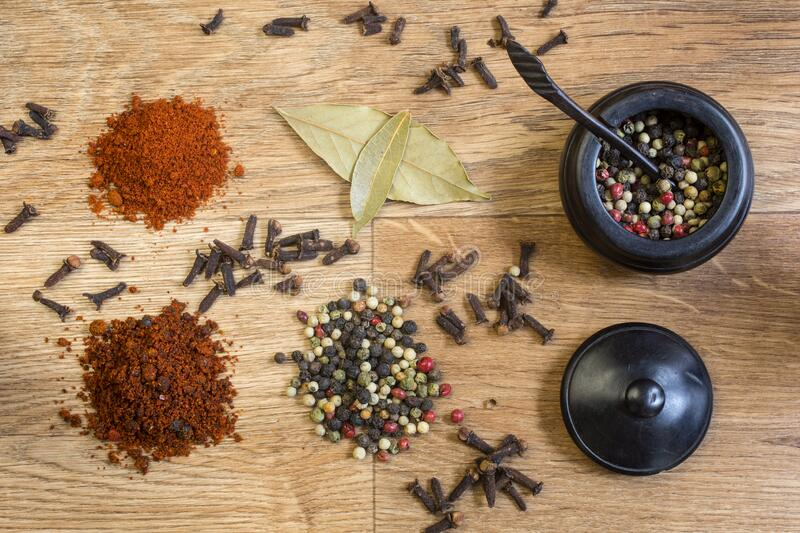 Spices and herbs on a wooden table royalty free stock photography