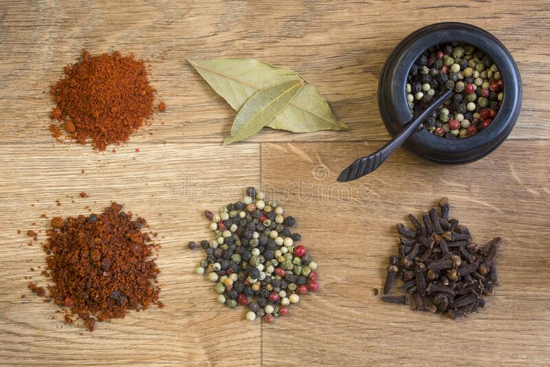 Spices and herbs on a wooden table stock photos