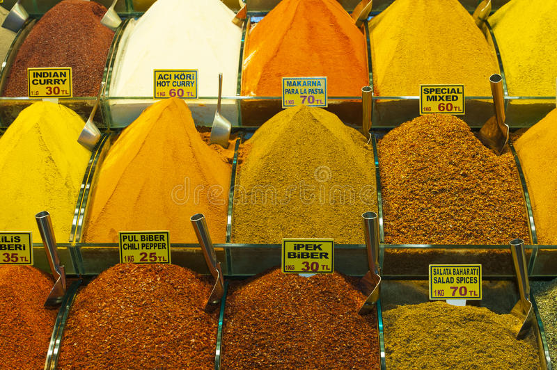 Spices at a market stall. Various spices on display at an indoor market stall stock photo