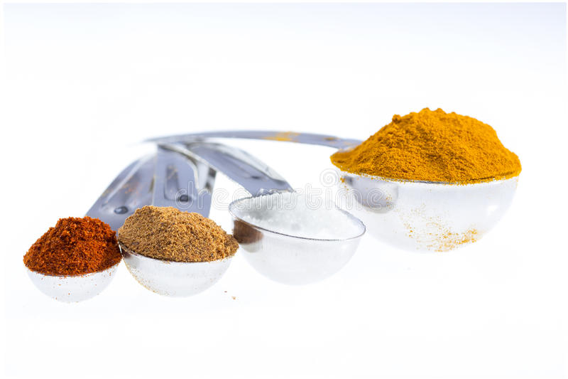 Spices in measuring spoons. stock photos