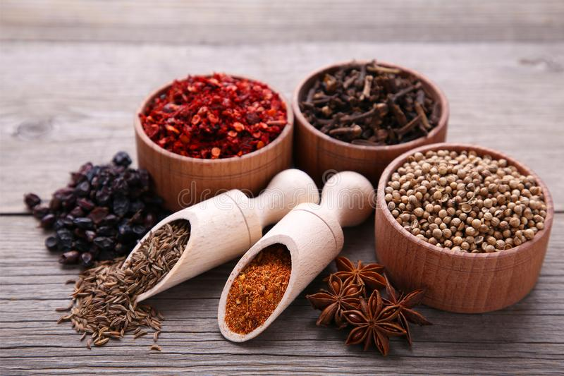 Spices mix on a grey wooden background. Top view royalty free stock photography
