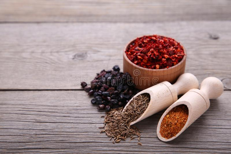 Spices mix on a grey wooden background. Top view royalty free stock photo