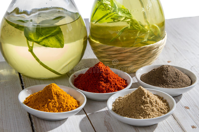 Spices and olive oil stock photography