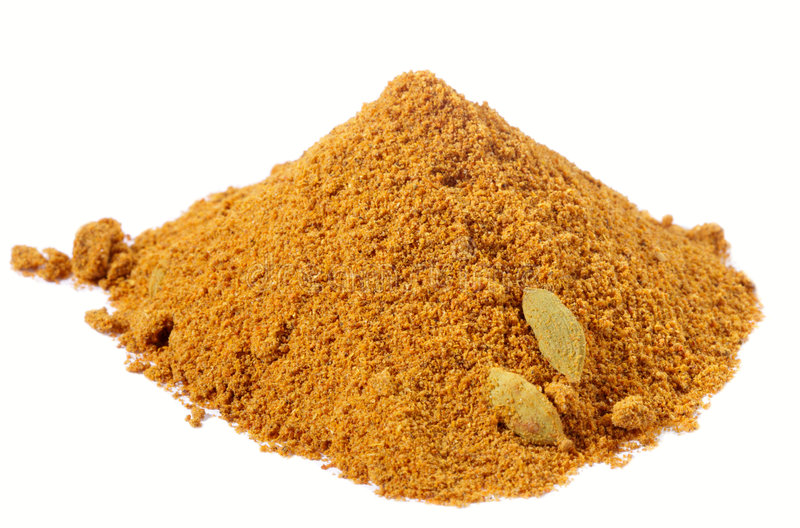 Spices - pile of chicken curry over white royalty free stock photo