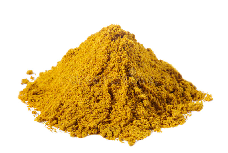 Spices - pile of Mild madras curry over white stock photography