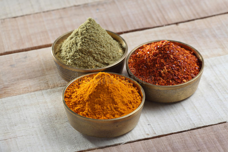 Spices powder in metal bowl stock photos