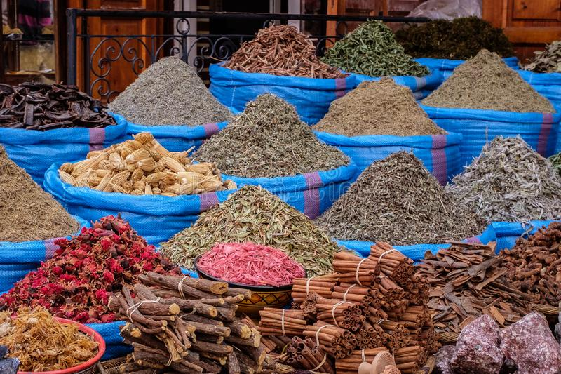 Spices For Sale, Marrakech Souk, Morocco. People, baskets, and rugs in the popular souks and shops in the center of Marrakesh, Morocco, North Africa royalty free stock image