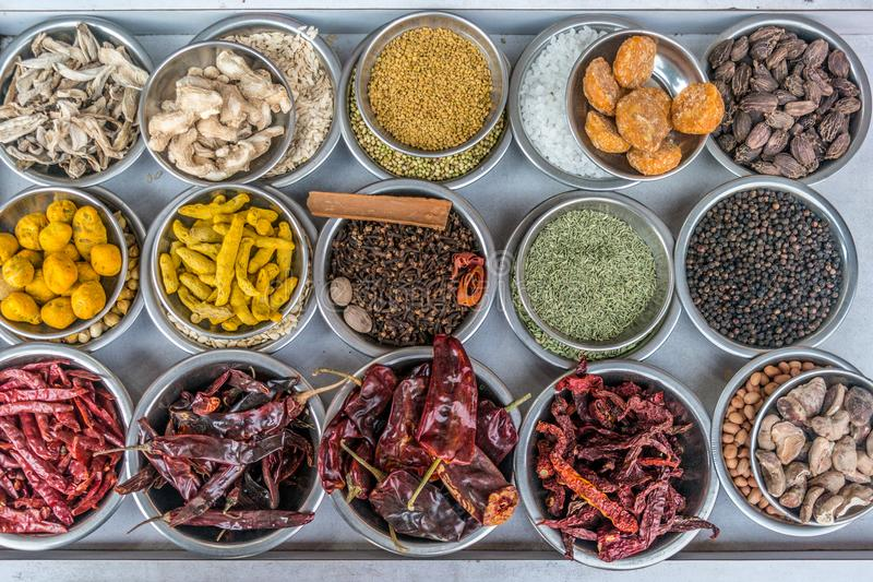 Spices at the spice market in Old Delhi, India. A top view of bowls filled with spices at a vendors stall in the largest spice market in Asia, the Khari Baoli stock photo