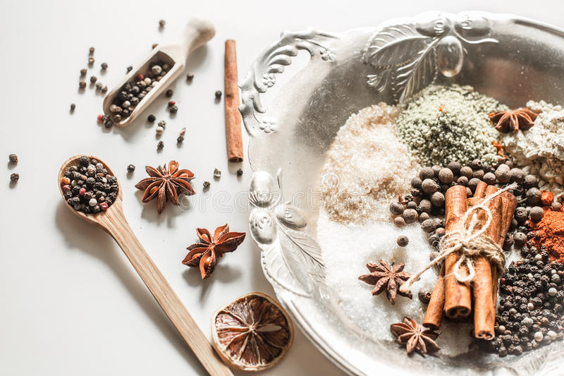 Spices in a spoon isolated on white background, royalty free stock photography
