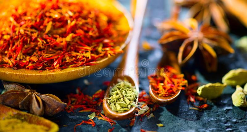 Spices. Various Indian spices on black stone table. Spice and herbs on slate background. Cooking stock images