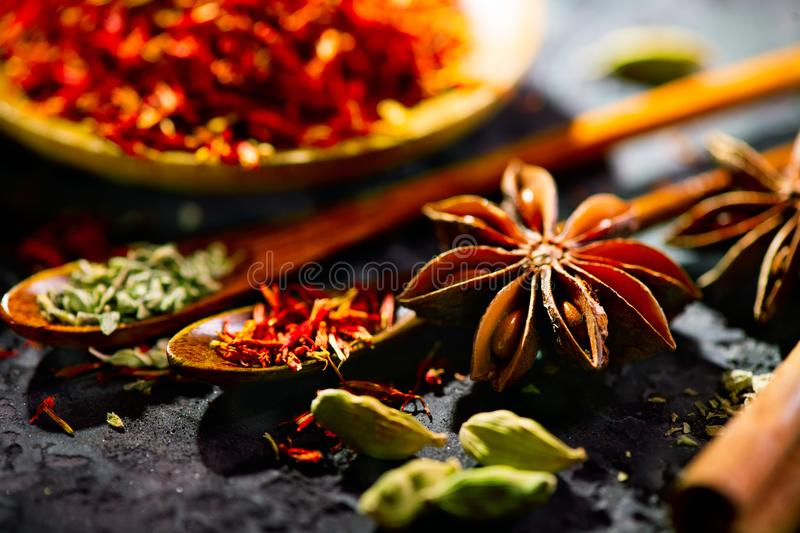 Spices. Various Indian spices on black stone table. Spice and herbs on slate background. Cooking ingredients stock photography