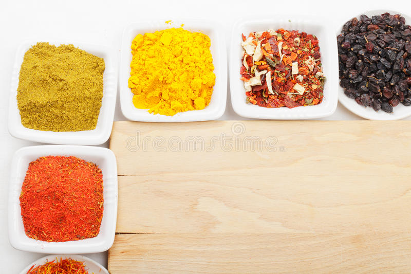 Spices at wooden board above view