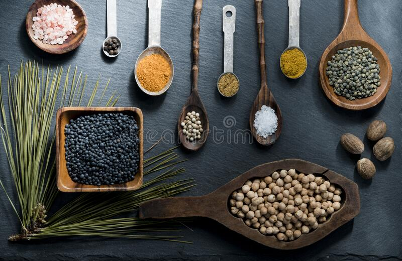 Spices in wooden bowls and spoons royalty free stock image