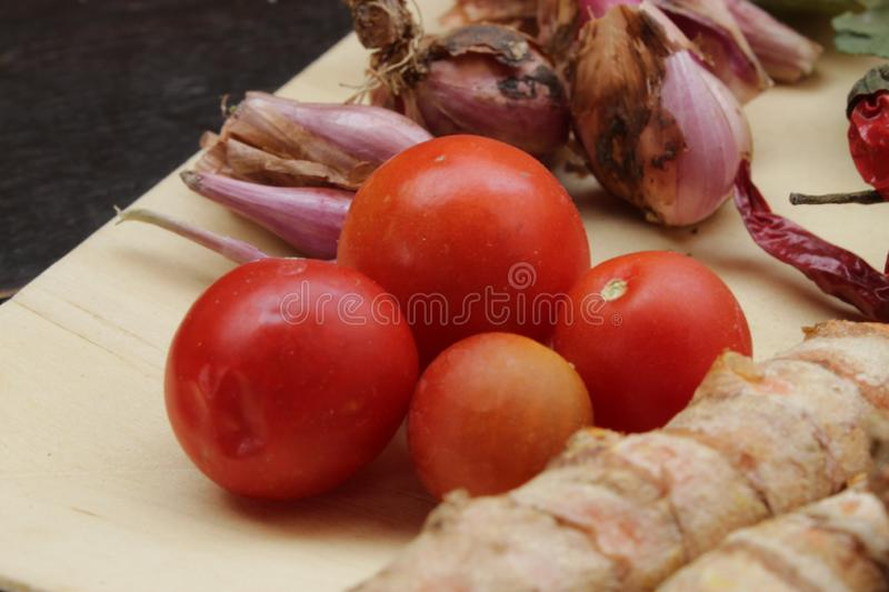 Spices on wooden plate. cooking ingredient royalty free stock photos