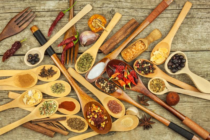 Spices on wooden spoons. Sales of exotic spices. Seasoning food. Aromatic spices. stock photo
