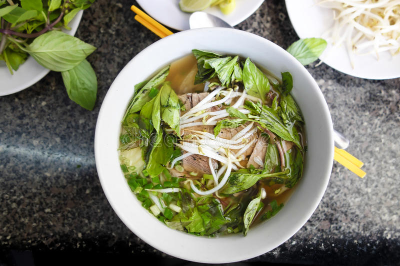 Spicy Vietnamese Pho Bo Beef noodle Soup. With Bean Sprouts stock photos