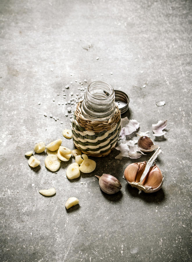 Spicy background. Fragrant garlic salt. On a stone background royalty free stock photos
