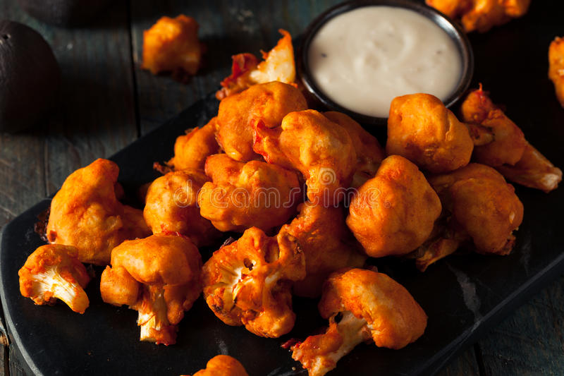 Spicy Breaded Buffalo Chicken Cauliflower. With Blue Cheese Sauce royalty free stock photos