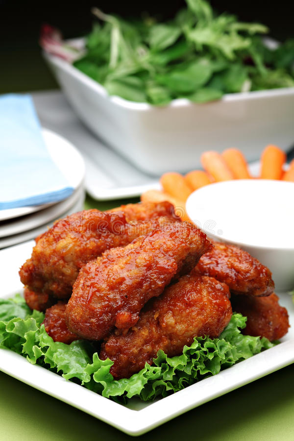 Spicy Buffalo style chicken wings royalty free stock photo