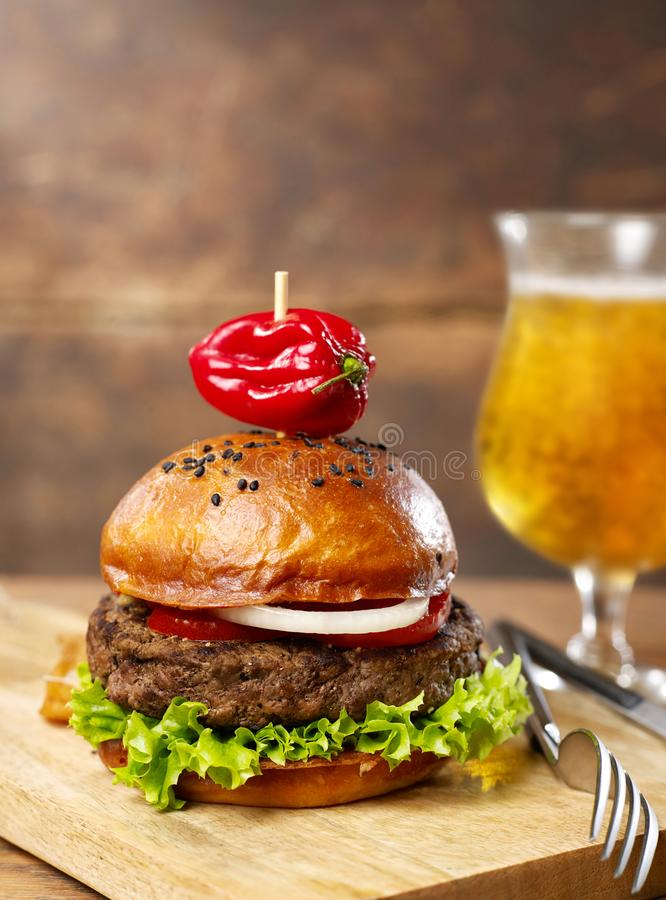 Spicy burger and beer stock photos