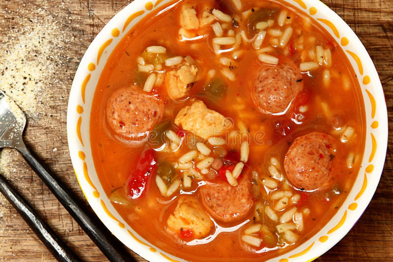 Spicy Cajun Chicken and Sausage Rice Gumbo on Table royalty free stock images