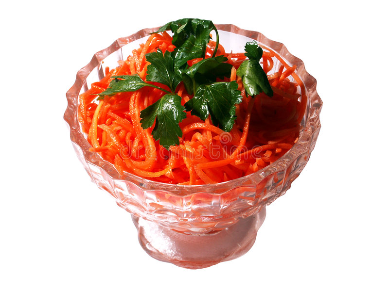 Spicy Carrot Salad. Korean carrot salad in crystal salad-bowl decorated with green parsley leafs. Dish is isolated on white background. There are variations of royalty free stock images