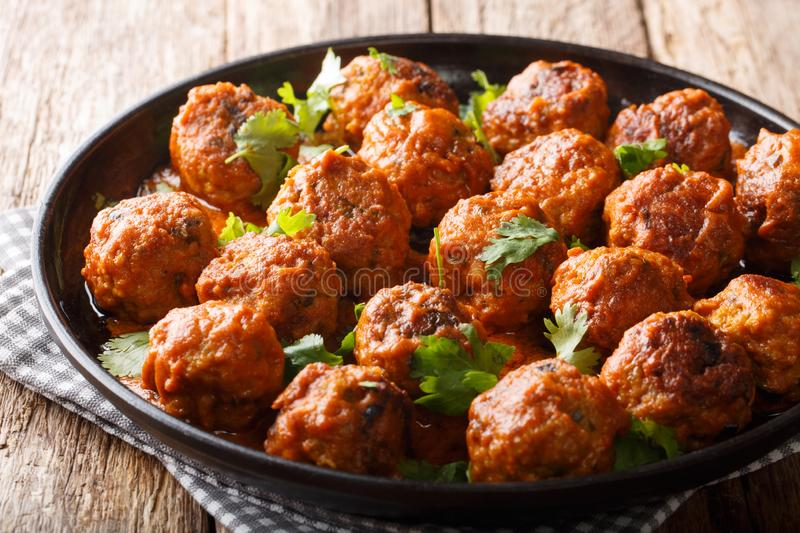 Spicy chicken meatballs in coconut sauce with red curry closeup on a plate. horizontal, asian style. Spicy chicken meatballs in coconut sauce with red curry stock images
