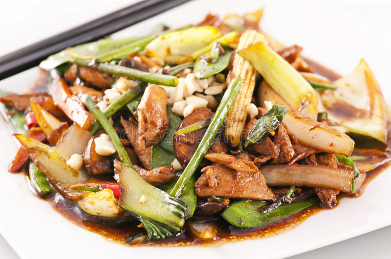 Spicy chicken with vegetables stock image