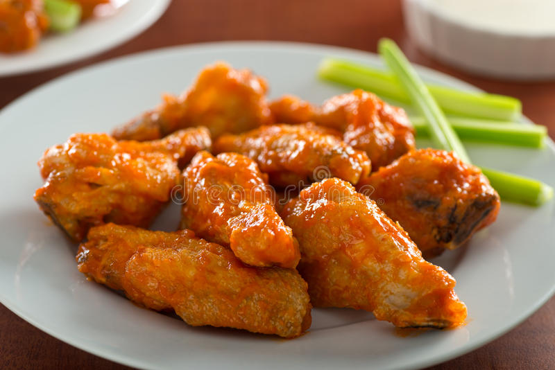 Spicy Chicken Wings with Sriracha Sauce stock photography