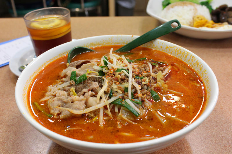 Spicy Chinese noodle soup. Hong Kong royalty free stock images