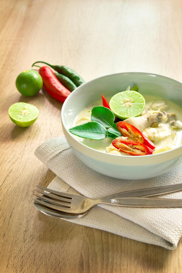 Spicy creamy coconut soup with chicken , Thai food called Tom Kha Gai on the wooden table stock photography