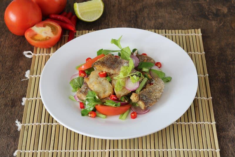 Spicy crispy fried trichogaster pectoralis salad stock photos