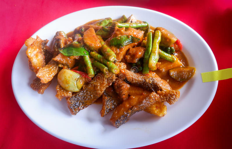 Spicy curry fish fried stock photos
