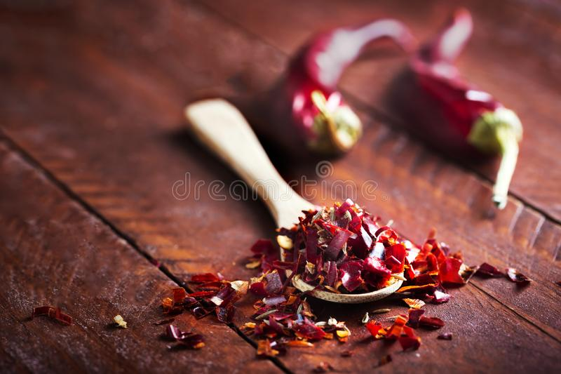 Spicy cutted Chili peper mix on wooden background royalty free stock photography