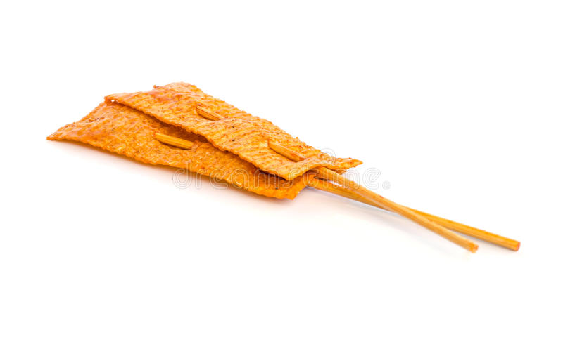 Spicy dried squid . Sweet and spicy dried squid isolate on white stock photo