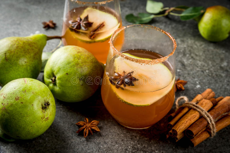 Spicy fall pear cocktail stock images