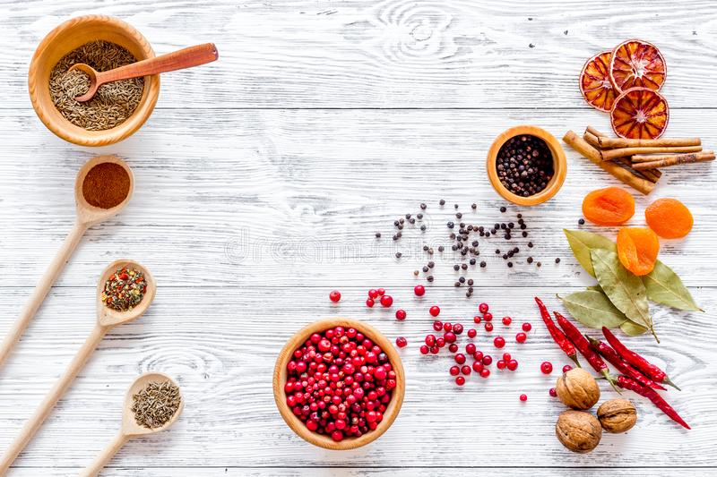Spicy food cooking with spices and dry herbs light wooden kitchen desk background top view mockup royalty free stock images
