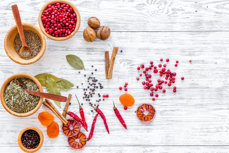 Spicy food cooking with spices and dry herbs light wooden kitchen desk background top view mockup royalty free stock image
