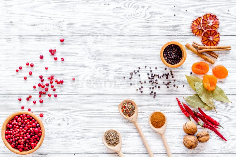 Spicy food cooking with spices and dry herbs light wooden kitchen desk background top view mockup stock photography