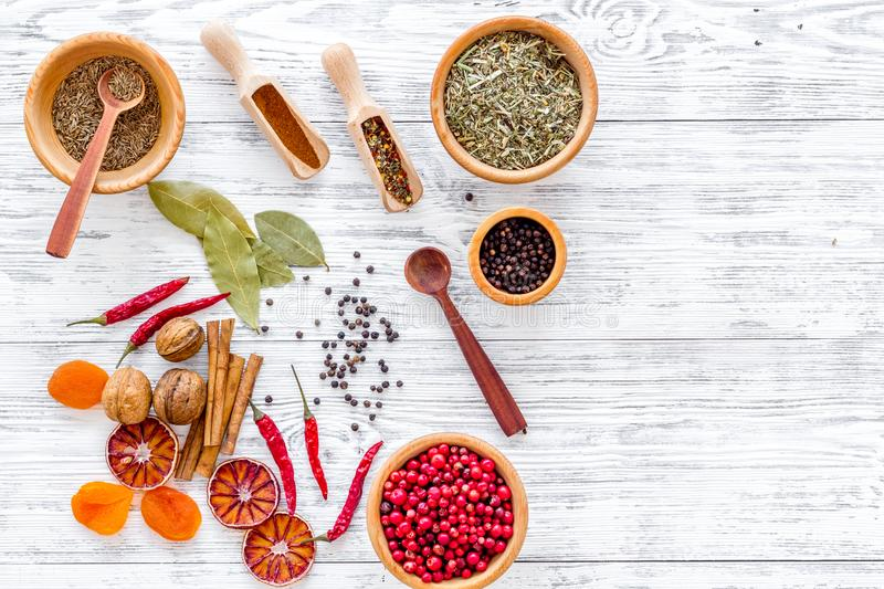 Spicy food cooking with spices and dry herbs light wooden kitchen desk background top view mockup royalty free stock photos